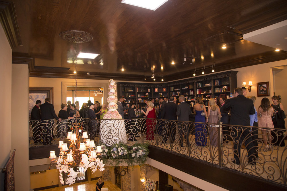 Guests enjoy cocktail hour in the library while we flipped the space. Luxury Las Vegas Wedding Planner Andrea Eppolito.  Image by AltF Photography.