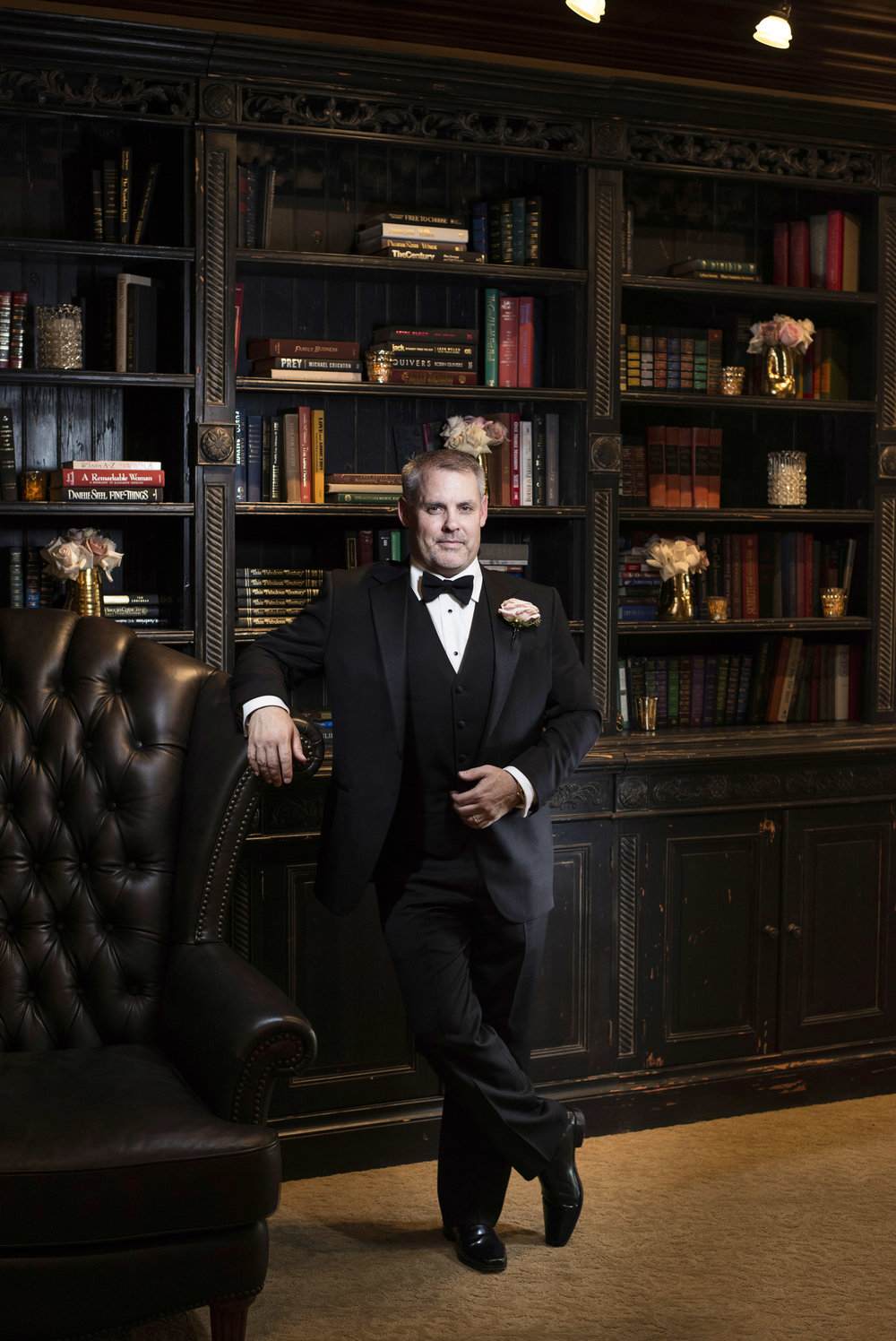 Groom photographed in his private library. Luxury Las Vegas Wedding Planner Andrea Eppolito.  Image by AltF Photography.