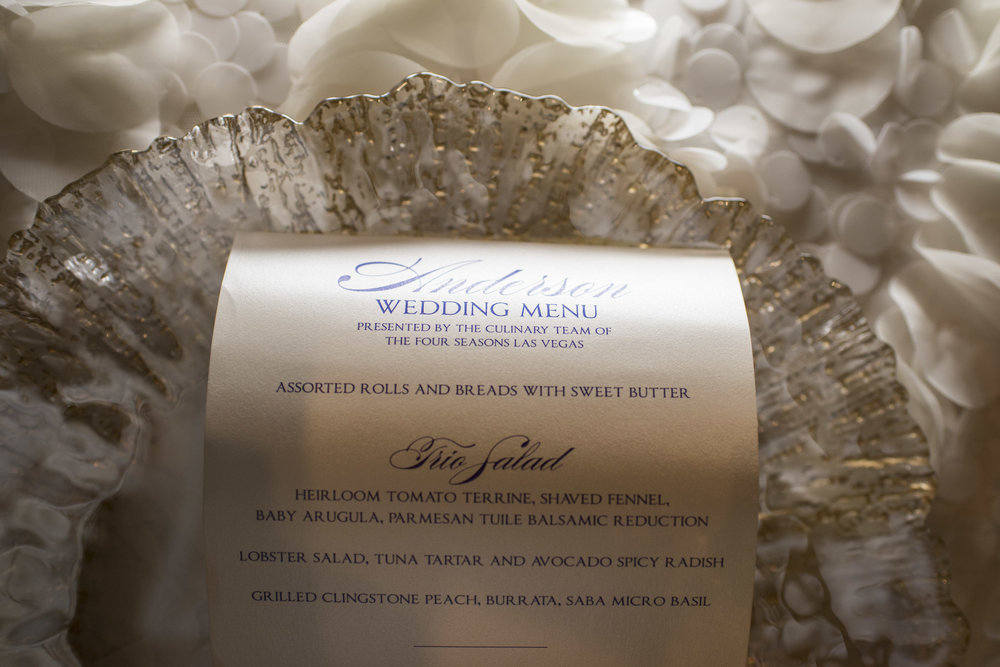 Scrolled wedding menu for luxury reception.  Personalized custom detail at Cinderella wedding. Luxury Las Vegas Wedding Planner Andrea Eppolito.  Image by AltF Photography.