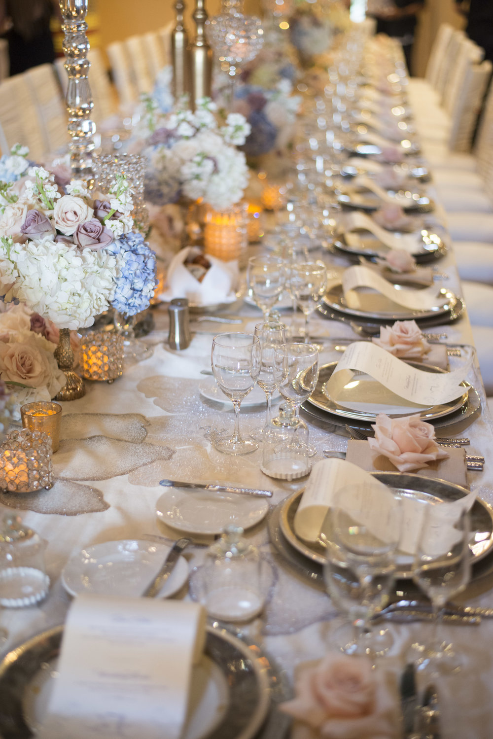 Details place setting with double charged, roses, and luxe linens.  Luxury Las Vegas Wedding Planner Andrea Eppolito.  Image by AltF Photography.