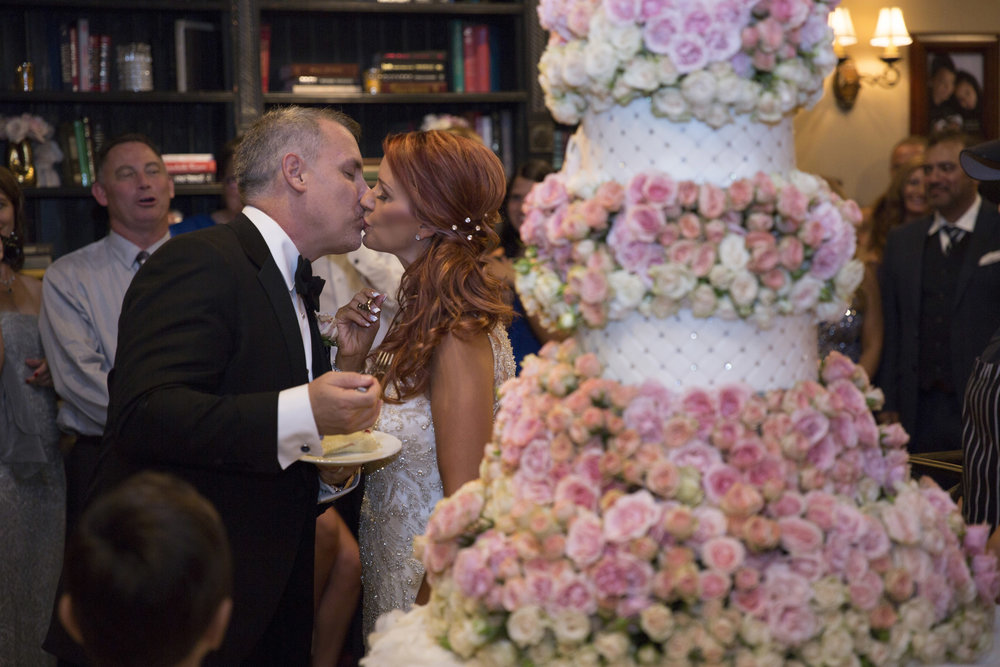 Kisses and wedding cake. Luxury Las Vegas Wedding Planner Andrea Eppolito.  Image by AltF Photography.