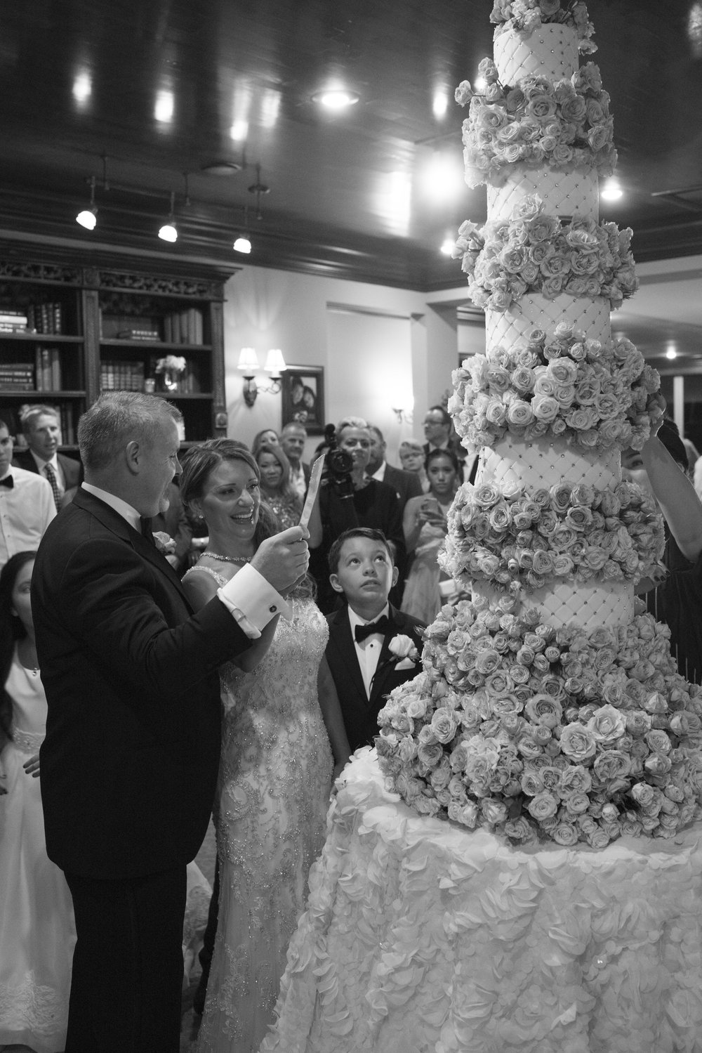 Bride & Groom cut the cake.  9 tiere 6 ft wedding cake in cinderella fairytale wedding. Luxury Las Vegas Wedding Planner Andrea Eppolito.  Image by AltF Photography.