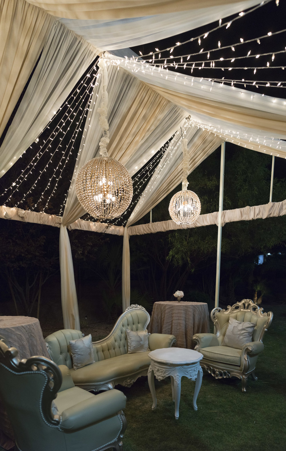 The perfect place to relax after a wedding.  Open air tent with bistro twinkle lights and hanging orbs. Luxury Las Vegas Wedding Planner Andrea Eppolito.  Image by AltF Photography.