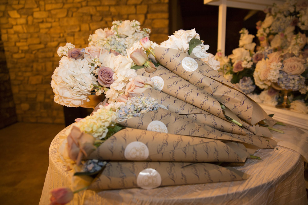 Thank you gift to guests - We broke down the centerpieces into bouquet for the guests to take home. Luxury Las Vegas Wedding Planner Andrea Eppolito.  Image by AltF Photography.