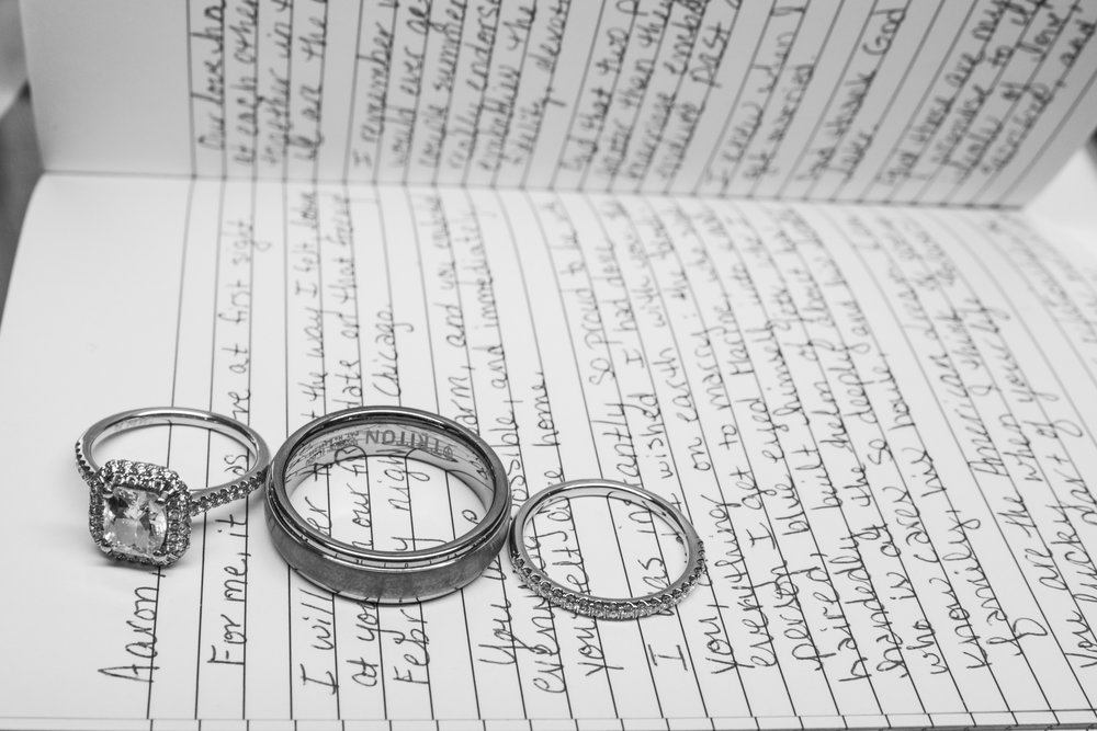Black and White photo of the couple's rings and the bride's wedding vows.  Photo by AltF Photography.