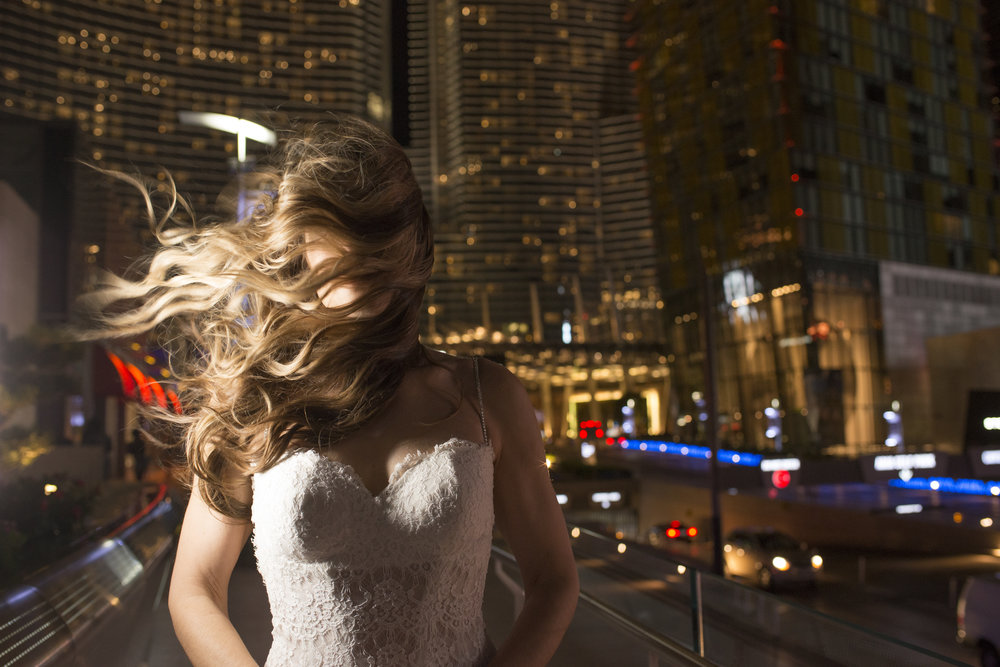Wind blown bride. Photo by Altf.