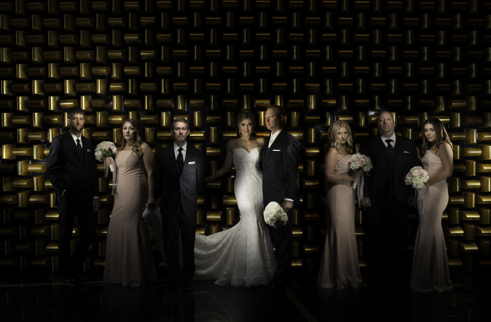 Dramatic Bridal Party Portrait in front of the God Wall at Mandarin Oriental.  Las Vegas Wedding Planner Andrea Eppolito.  Image by AltF.