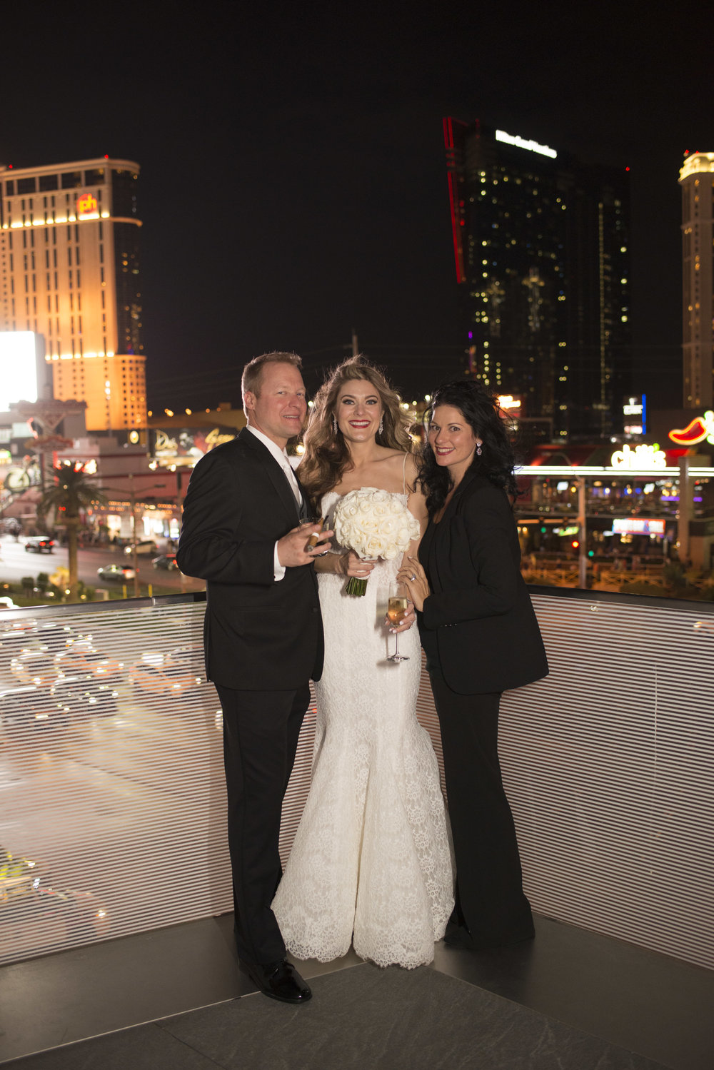 Las Vegas Wedding Planner Andrea Eppolito with bride and groom at Mandarin Oriental.  Image by AltF.