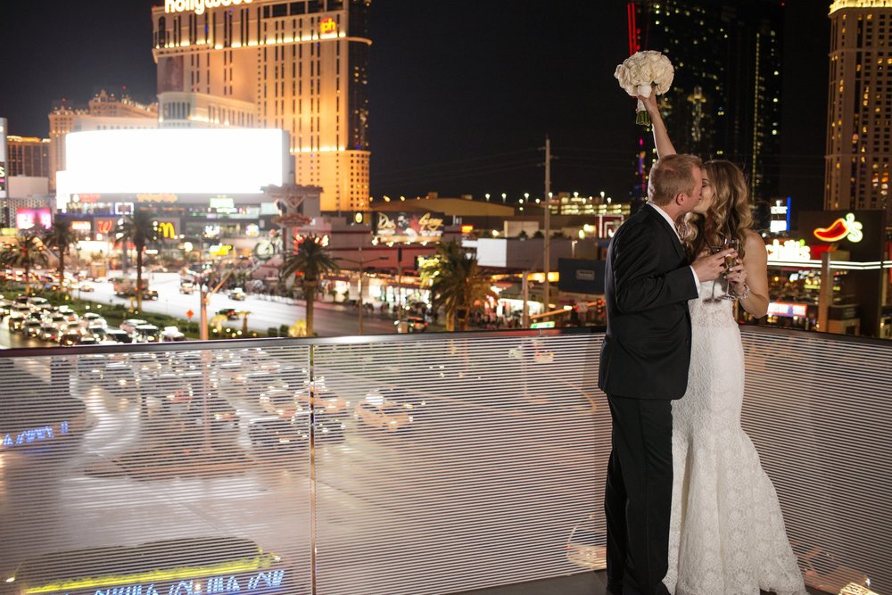 Bride & groom triumphant on their windy wedding day at Mandarin Oriental. Las Vegas Wedding Planner Andrea Eppolito.  Image by AltF.