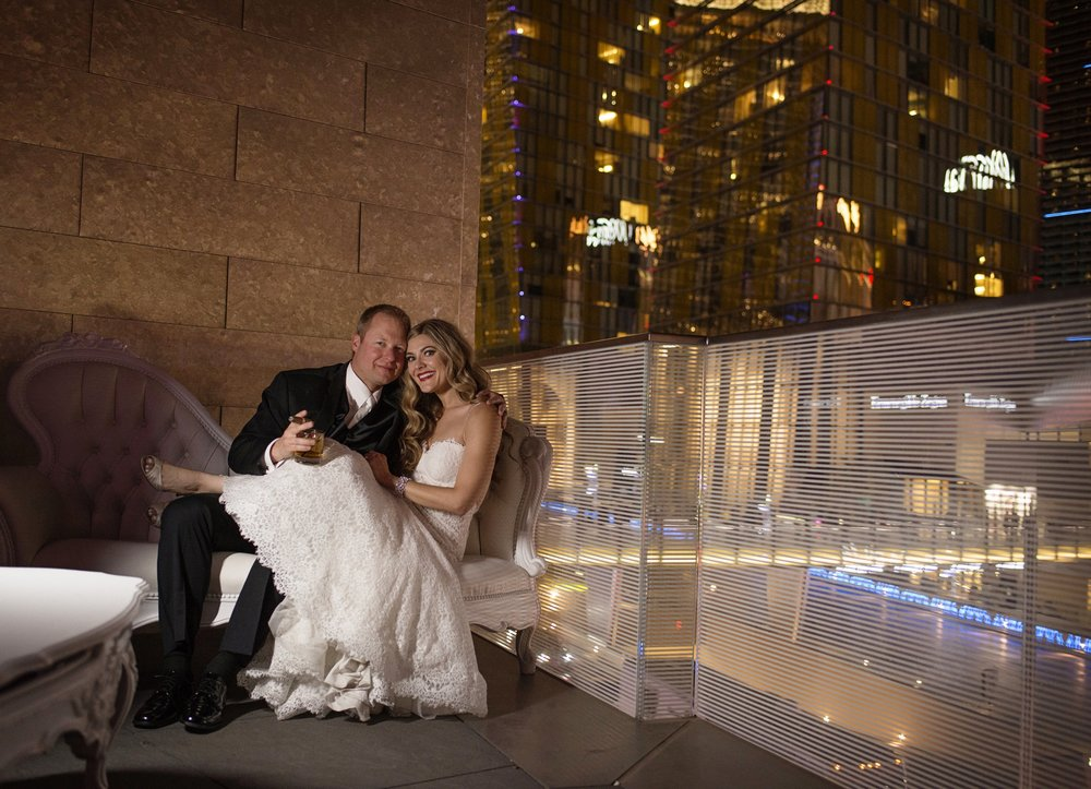 Scotch and cigars on the balcony of the Mandarin Oriental Ballroom. Las Vegas Wedding Planner Andrea Eppolito.  Image by AltF.