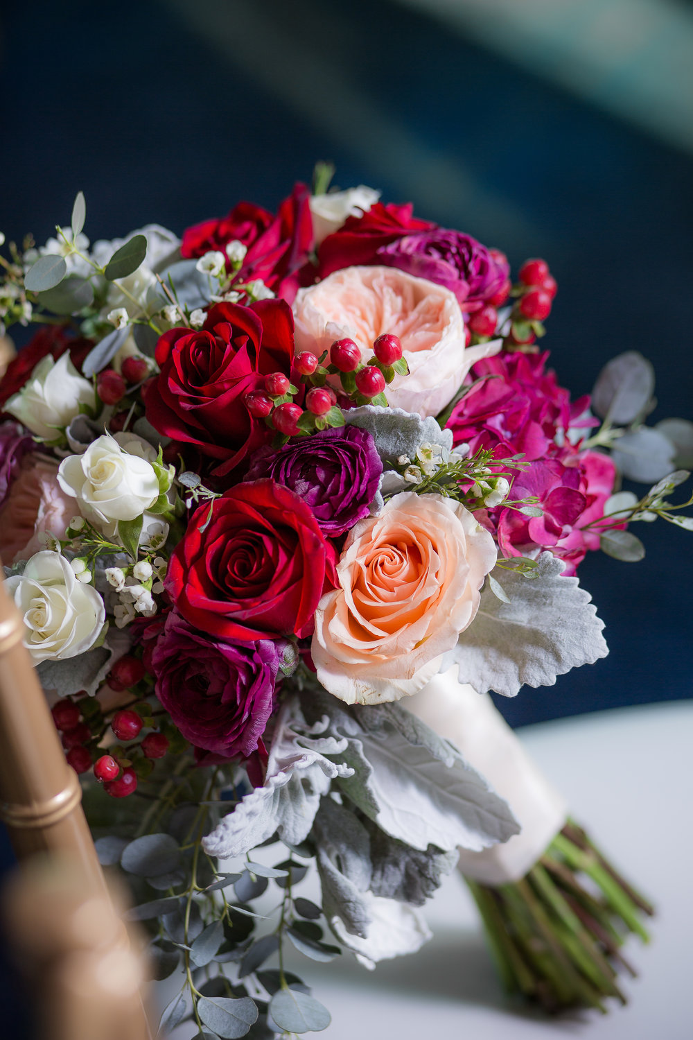 Red and fuschia bridal bouquet for wedding reception.   Styled Wedding Shoot inspired by French Blue by   Las Vegas Wedding Planner  Andrea Eppolito .  Photography by   Rebecca Marie  .  Floral and Decor by   By Dzign  .
