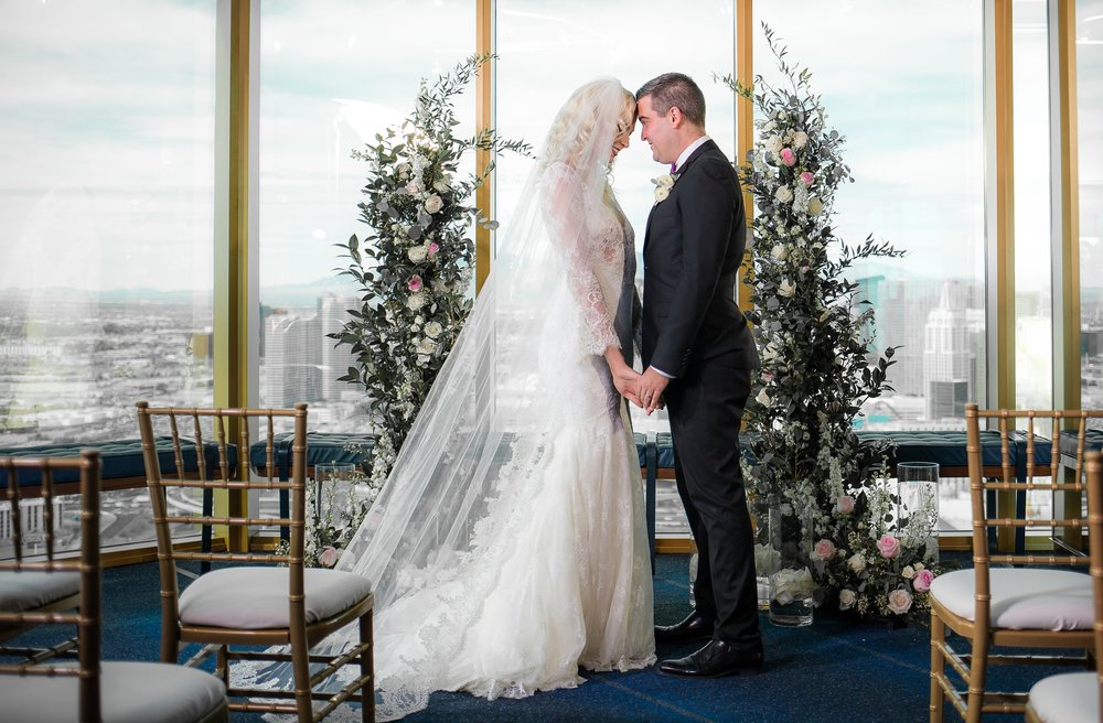 Bride and Groom in Las Vegas Wedding at Rivea.  Unique locations for a small Vegas Wedding.      Styled Wedding Shoot inspired by French Blue.    Las Vegas Wedding Planner  Andrea Eppolito .  Photography by   Rebecca Marie  .  Floral and Decor by   By Dzign  .  Beauty by   Amelia C & Co  .  Shot at Rivea at The Delano.