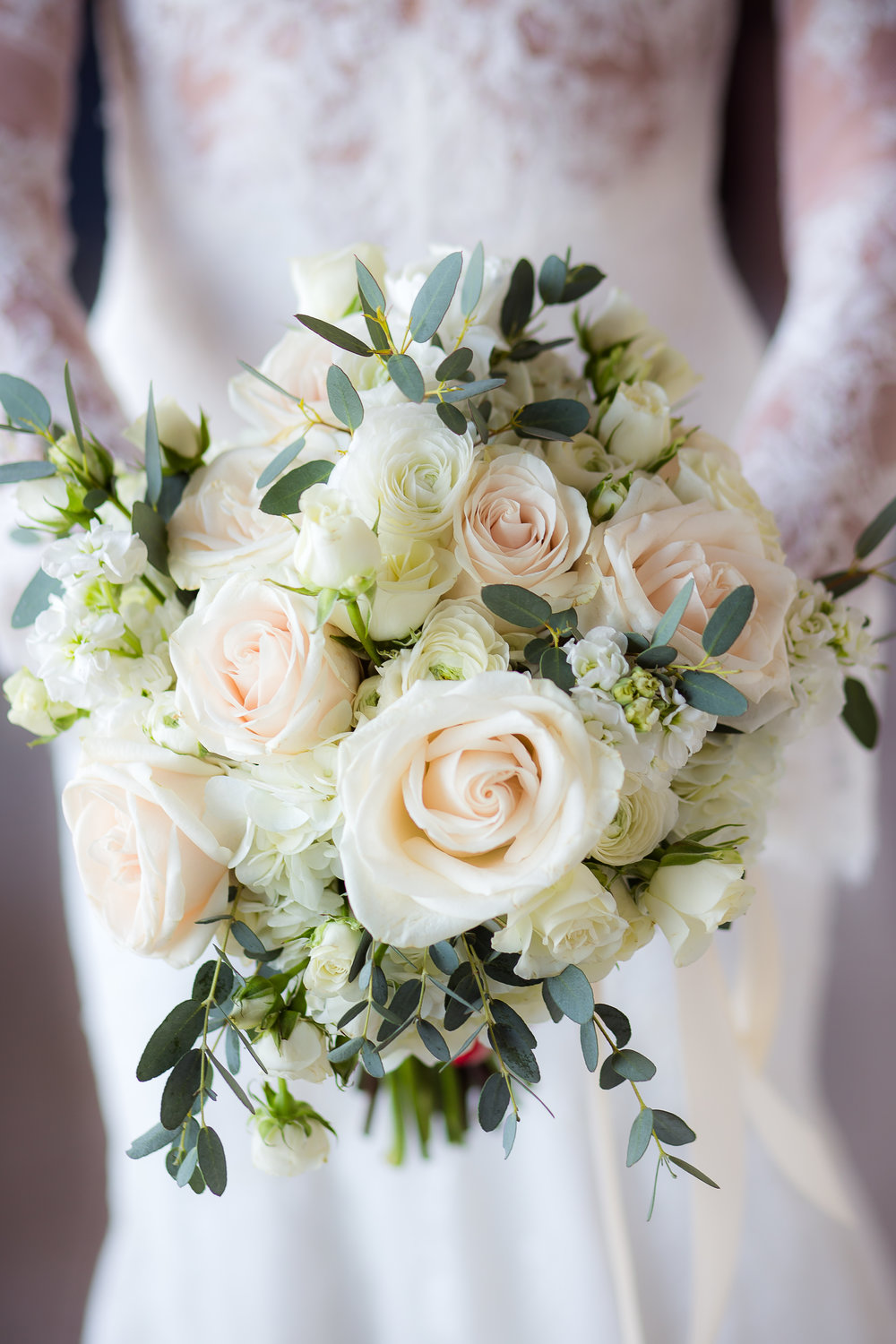 White, ivory, and green bridal bouquet.      Styled Wedding Shoot inspired by French Blue.    Las Vegas Wedding Planner  Andrea Eppolito .  Photography by   Rebecca Marie  .  Floral and Decor by   By Dzign  .  Beauty by   Amelia C & Co  .  Shot at Rivea at Teh Delano.