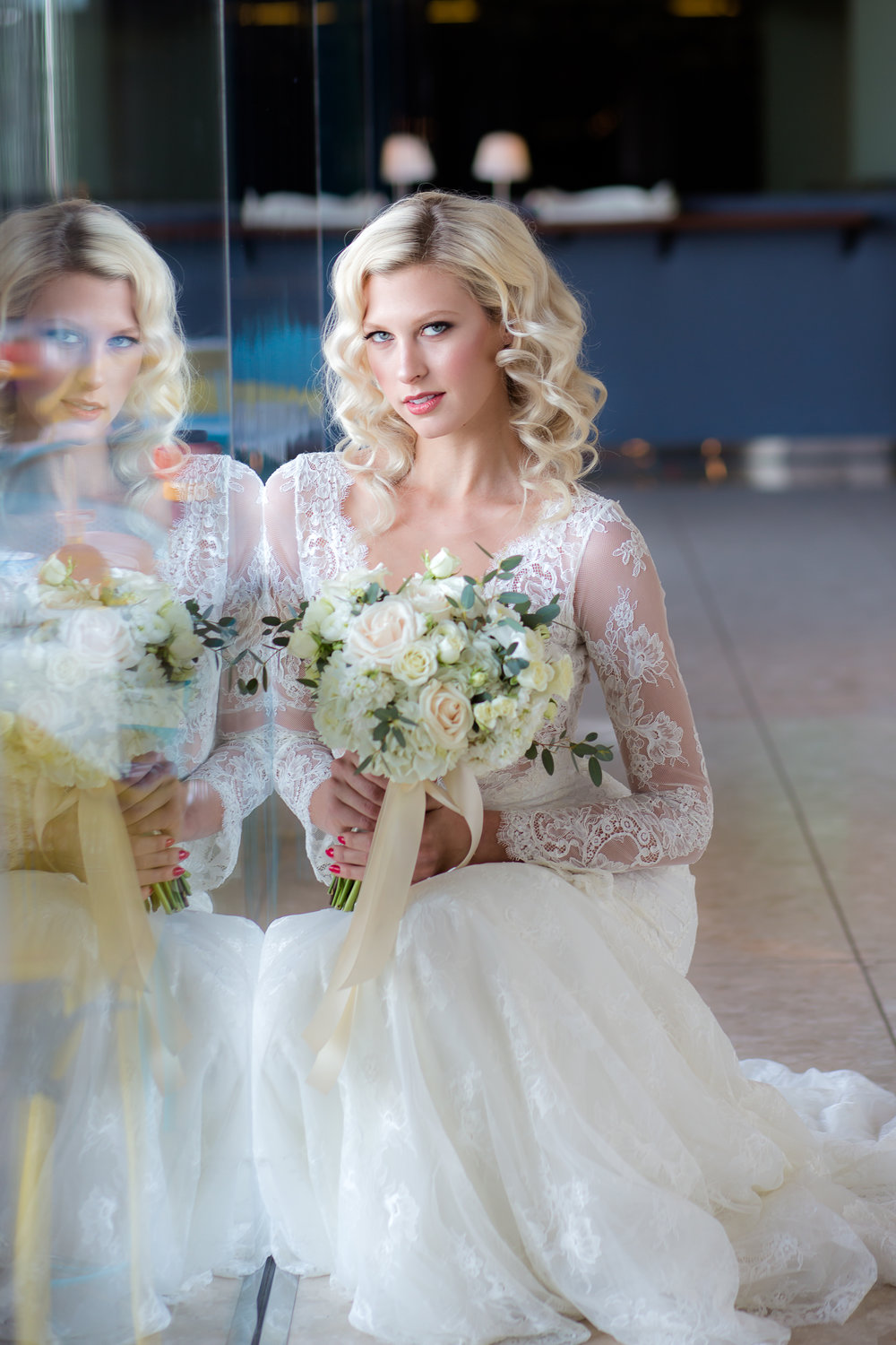 Blong bride in Olvi wedding dress at wedding at Mandalay Bay.      Styled Wedding Shoot inspired by French Blue.    Las Vegas Wedding Planner  Andrea Eppolito .  Photography by   Rebecca Marie  .  Floral and Decor by   By Dzign  .  Beauty by   Amelia C & Co  .  Shot at Rivea at Teh Delano.