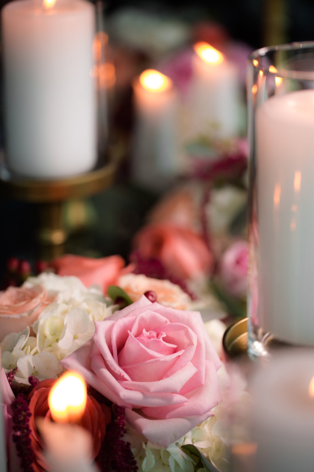 Pink and white rustic and romantic centerpieces with candles.      Styled Wedding Shoot inspired by French Blue.    Las Vegas Wedding Planner  Andrea Eppolito .  Photography by   Rebecca Marie  .  Floral and Decor by   By Dzign  .  Beauty by   Amelia C & Co  .  Shot at Rivea at The Delano.