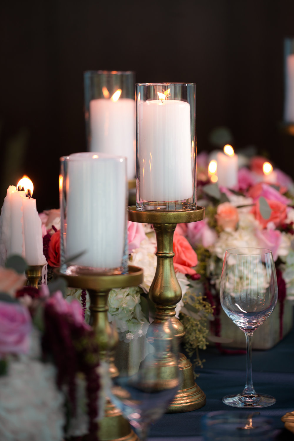 Tall pillar candle centgerpieces.     Styled Wedding Shoot inspired by French Blue.    Las Vegas Wedding Planner  Andrea Eppolito .  Photography by   Rebecca Marie  .  Floral and Decor by   By Dzign  .  Beauty by   Amelia C & Co  .  Shot at Rivea at The Delano.
