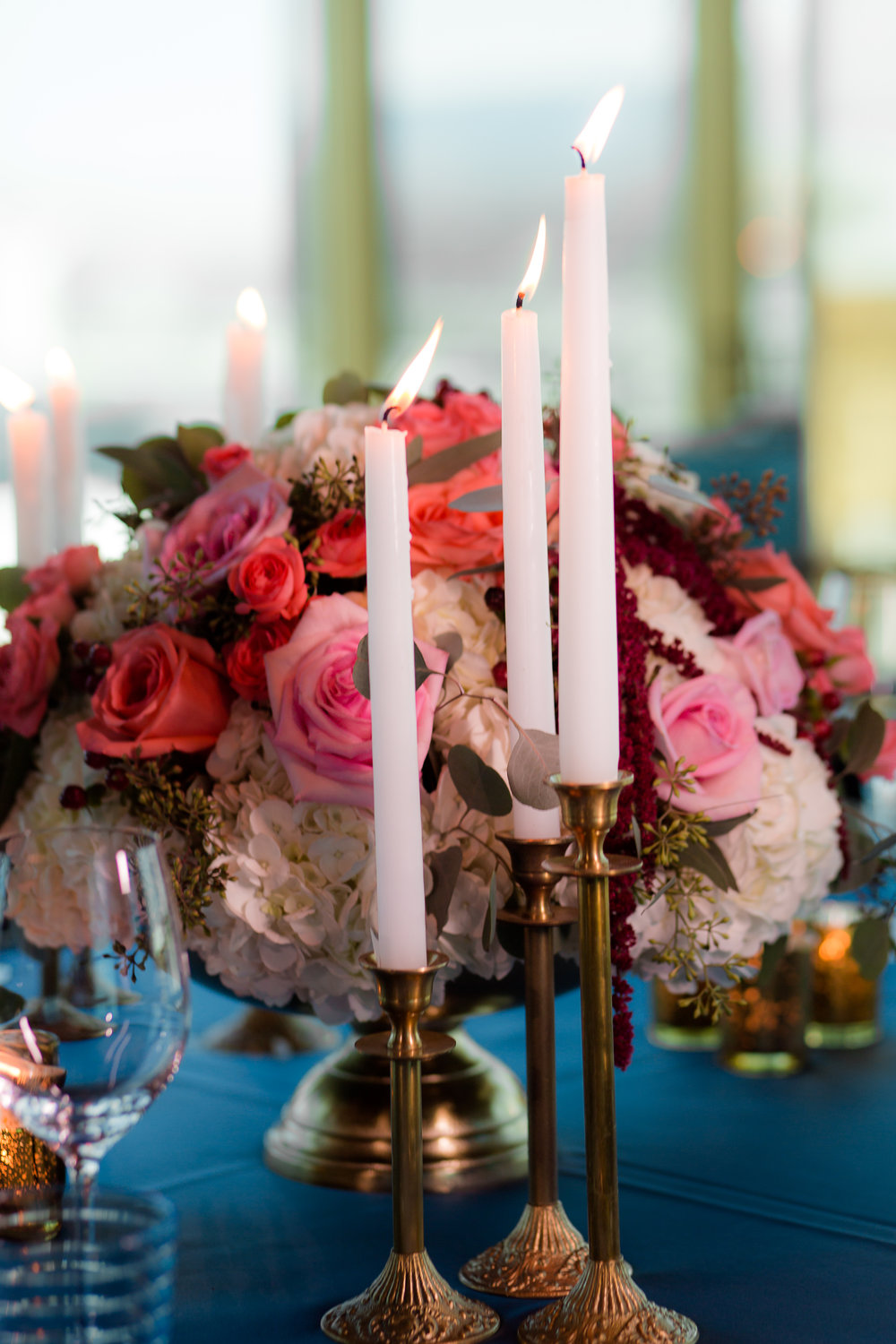 Tall taped candles at luxe, upscale French wedding.  Styled Wedding Shoot inspired by French Blue by Las Vegas Wedding Planner Andrea Eppolito.  Photography by   Rebecca Marie  .  Floral and Decor by   By Dzign  .  Beauty by   Amelia C & Co  .  Shot at Rivea at T  he Delano.