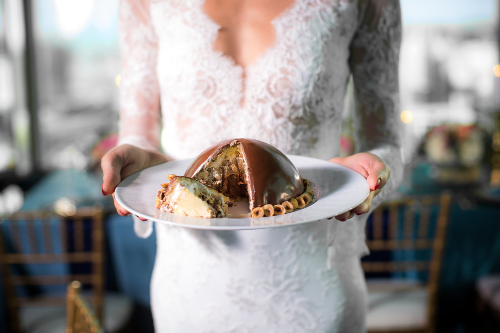 The couples served hocolate Bomb Dome Cakes in place of a traditional wedding cake.   Styled Wedding Shoot inspired by French Blue by Las Vegas Wedding Planner Andrea Eppolito.  Photography by   Rebecca Marie  .  Floral and Decor by   By Dzign  .  Beauty by   Amelia C & Co  .  Shot at Rivea at T  he Delano.
