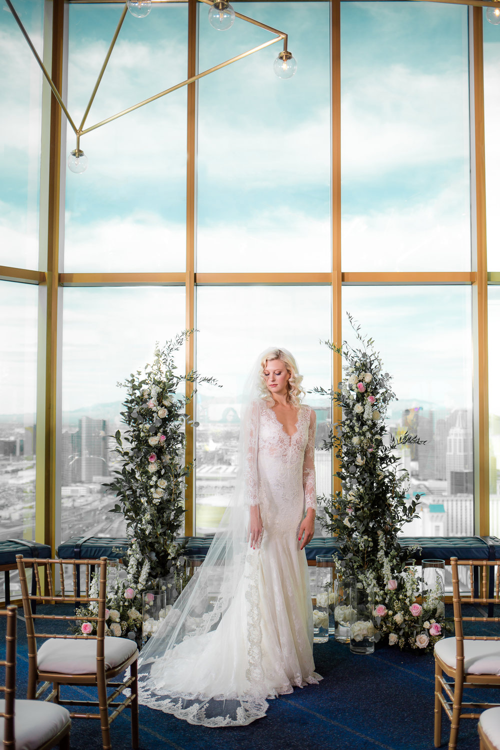 Bride in Olvi lace wedding gown.   Styled Wedding Shoot inspired by French Blue by Las Vegas Wedding Planner Andrea Eppolito.  Photography by   Rebecca Marie  .  Floral and Decor by   By Dzign  .  Beauty by   Amelia C & Co  .  Shot at Rivea at T  he Delano.