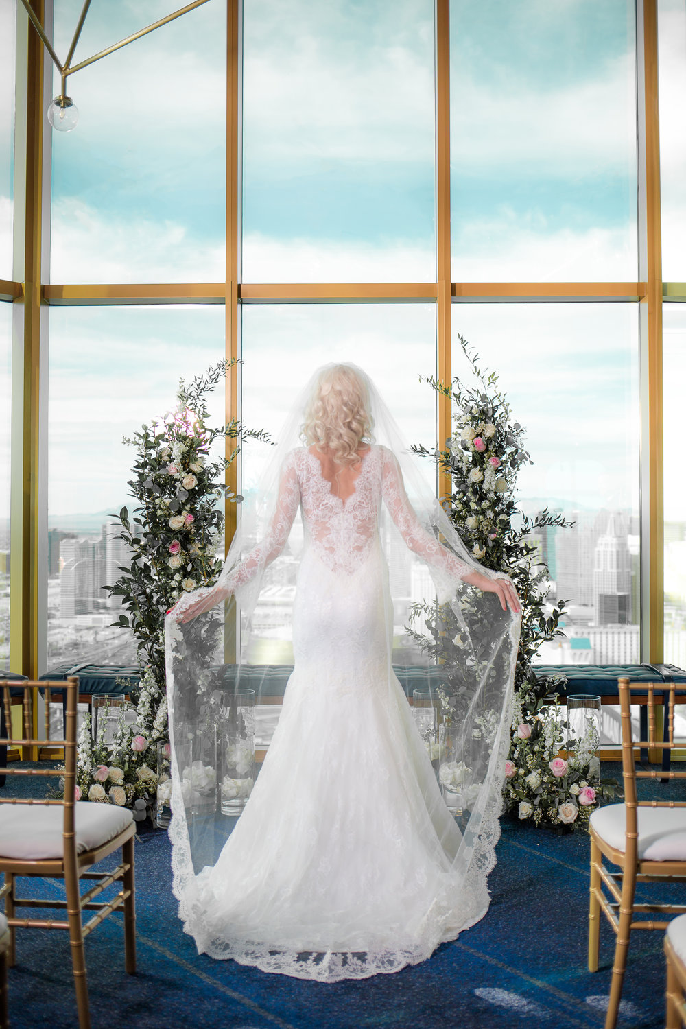 Deep V Back wedding gown in lace by Olv.   Styled Wedding Shoot inspired by French Blue by Las Vegas Wedding Planner Andrea Eppolito.  Photography by   Rebecca Marie  .  Floral and Decor by   By Dzign  .  Beauty by   Amelia C & Co  .  Shot at Rivea at T  he Delano.