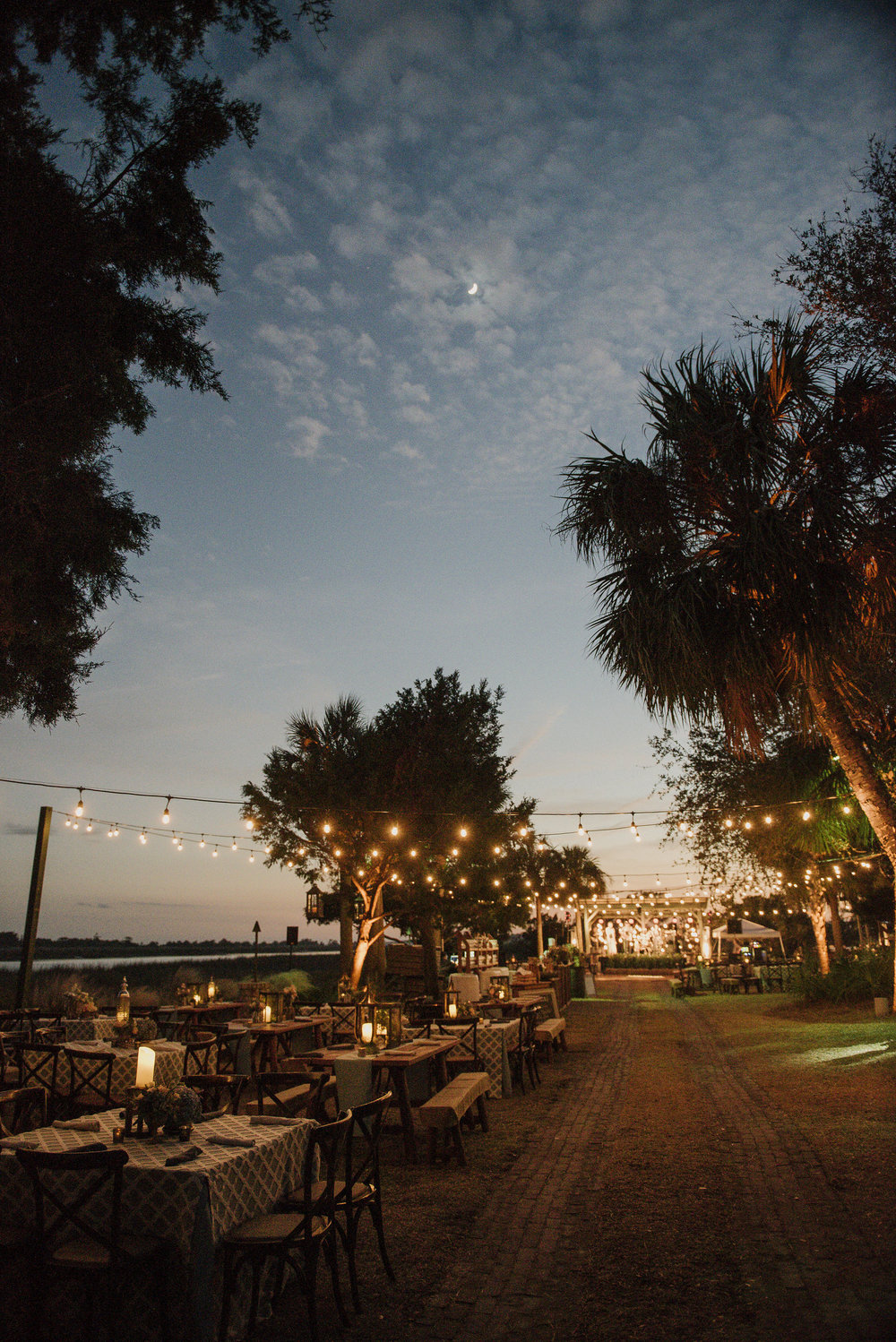 Party beneath the stars!  We spent our first night al fresco with a water-front mixer under bistro lights. Photo by Carla Ten Eyck.