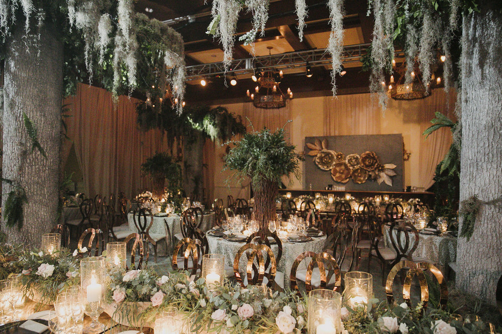 The Gala was done in shades of green and gold, with moss dripping from the ceiling and a mix of round and long banquet tables.   Decor by The Vine and Party Table Linen Rentals.  Photo by John Cain.