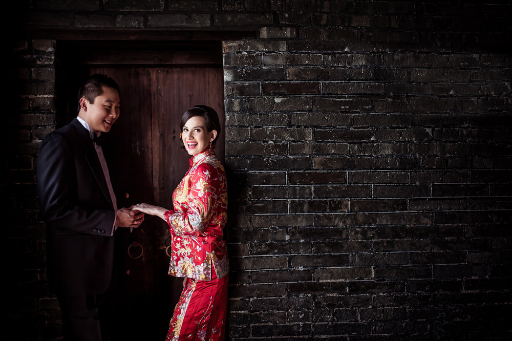 Las Vegas Wedding Planner Andrea Eppolito shares these Hong Kong Engagement Photos taken by  Aperture Photo .  Bride in red chinois outfit.