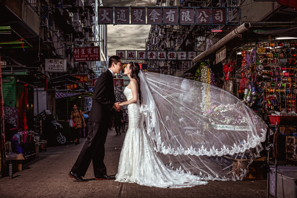 Las Vegas Wedding Planner Andrea Eppolito shares these Hong Kong Engagement Photos taken by  Aperture Photo . Bride to be in lace western-style white wedding dress.