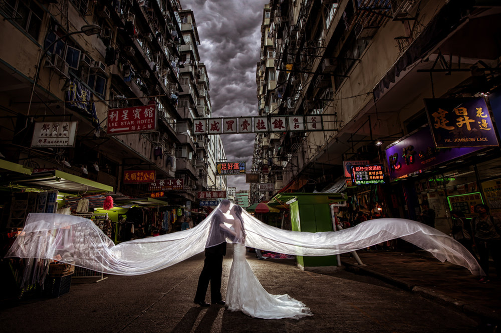 Las Vegas Wedding Planner Andrea Eppolito shares these Hong Kong Engagement Photos taken by  Aperture Photo . Bride in white lace wedding dress in engagement photos.