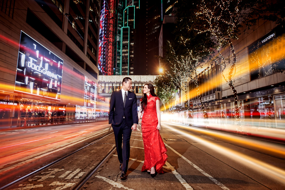 Las Vegas Wedding Planner Andrea Eppolito shares these Hong Kong Engagement Photos taken by  Aperture Photo . Bride in a red lace gown.