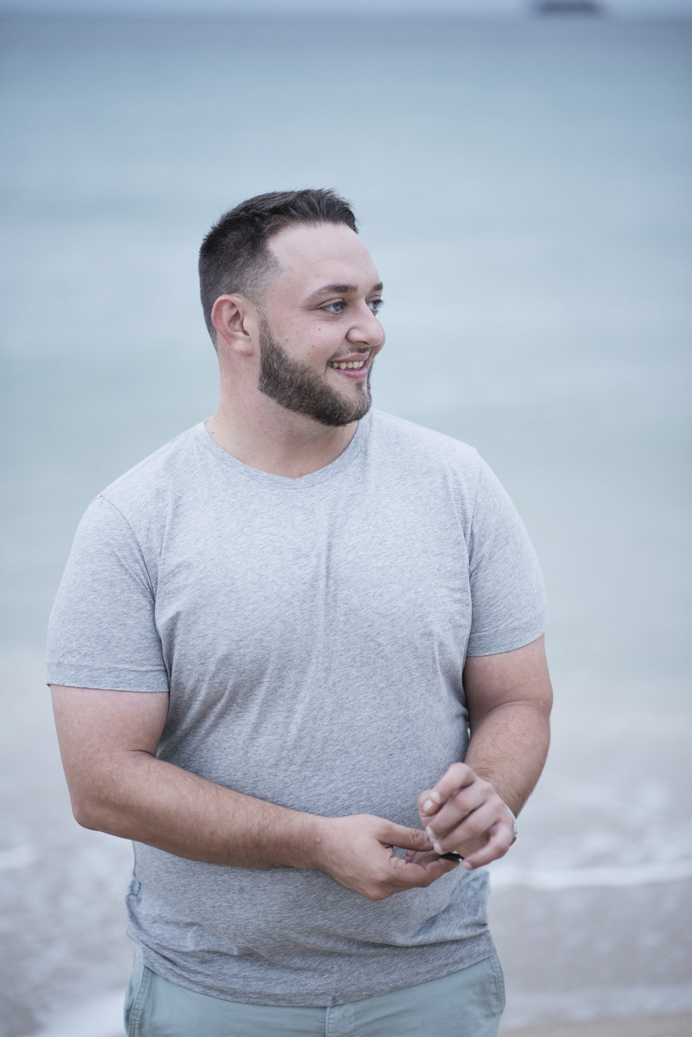 Groom to be Ben on the beach in Florida.  Engagement photos in Florida.  Las Vegas Wedding Planner Andrea Eppolito.  Image by AltF Photography.