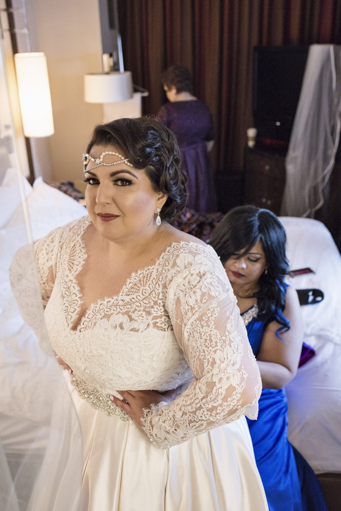 Bride getting ready wearing front headband.  Las Vegas Wedding Planner Andrea Eppolito.  Image by AltF Photography.