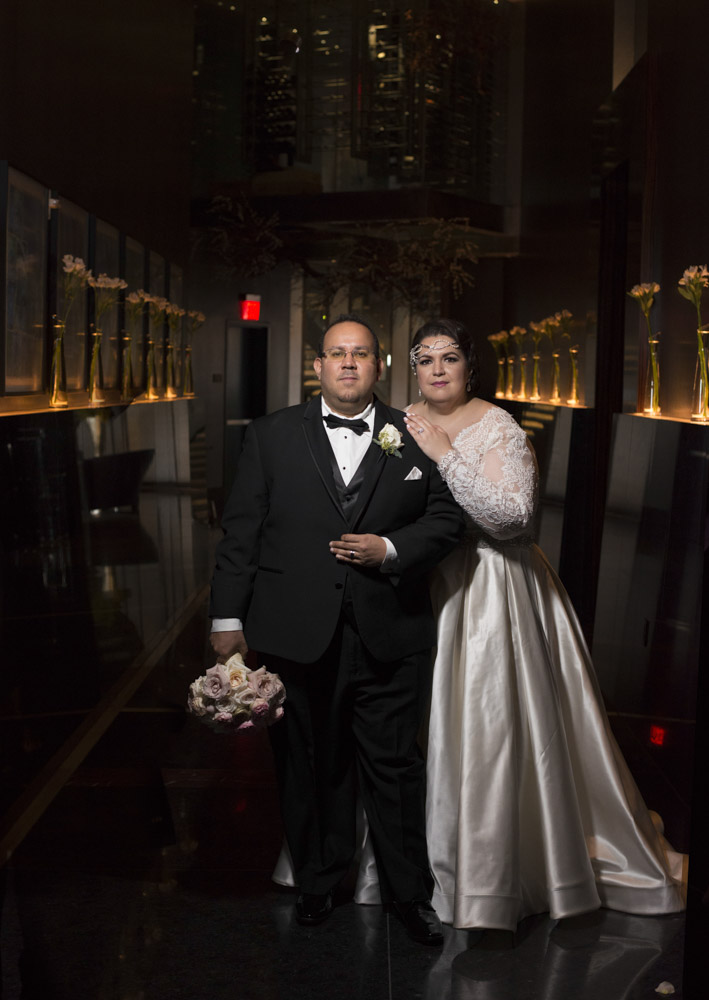 Bride and groom at Mandarin Oriental.  Las Vegas Wedding Planner Andrea Eppolito.  Image by AltF Photography.   Floral and Decor by Destinations by Design.