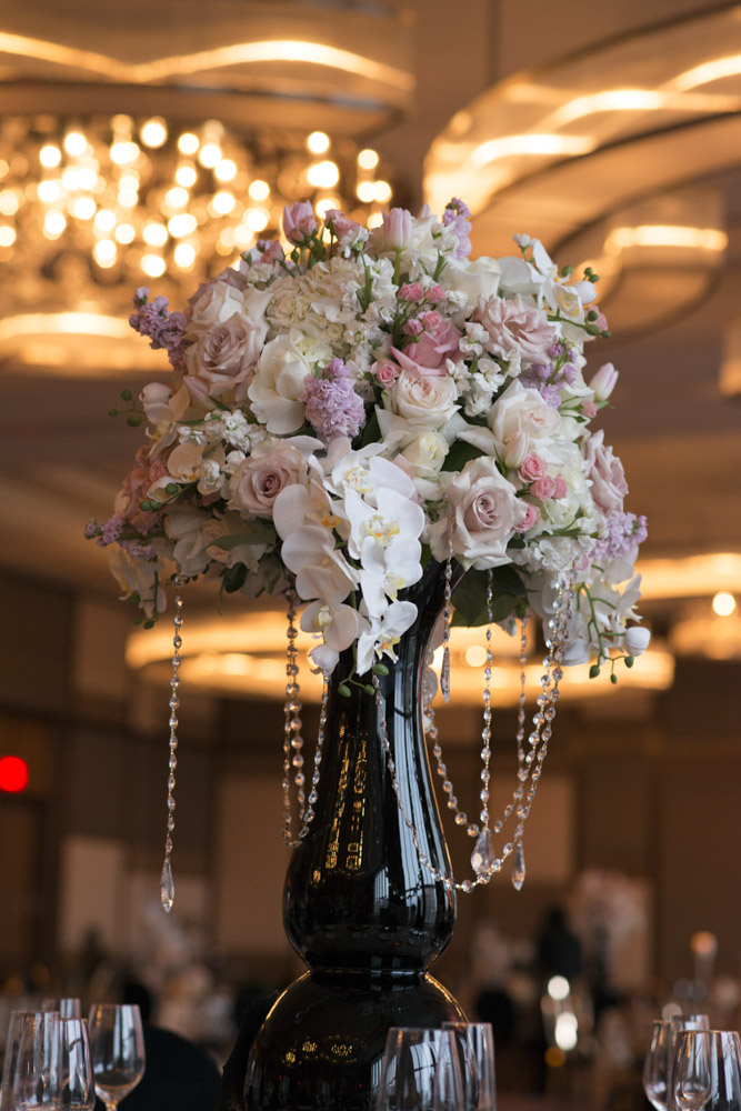 White and pink centerpiece in black vase.  Las Vegas Wedding Planner Andrea Eppolito.  Image by AltF Photography.   Floral and Decor by Destinations by Design. Luxury Wedding at Mandarin Oriental.