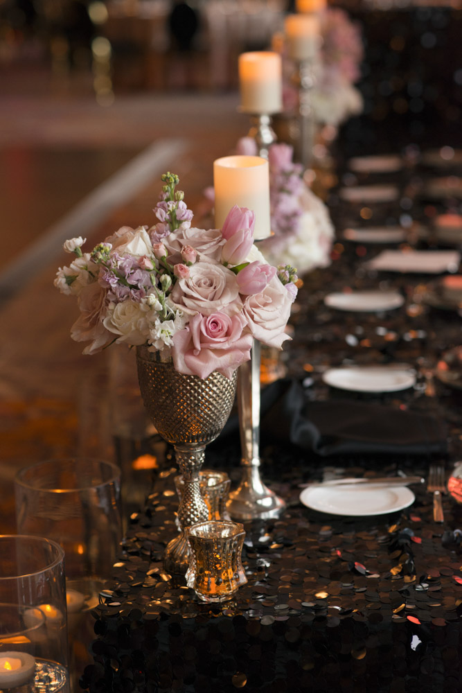 Long banquet table with small pops of pink flower.  Las Vegas Wedding Planner Andrea Eppolito.  Image by AltF Photography.   Floral and Decor by Destinations by Design. Luxury Wedding at Mandarin Oriental.