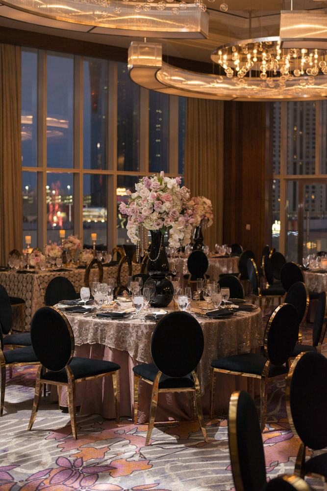 Tound tables with tall oink and black centerpieces.  Las Vegas Wedding Planner Andrea Eppolito.  Image by AltF Photography.   Floral and Decor by Destinations by Design. Luxury Wedding at Mandarin Oriental.