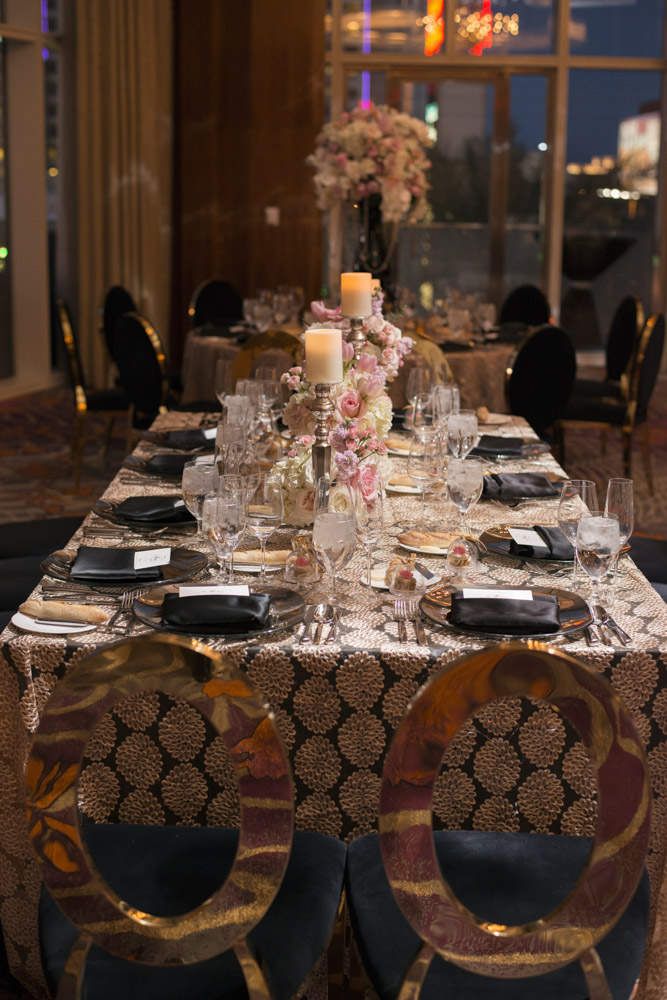 Long tables with low centerpieces and candles.  Black and gold wedding chairs.   Las Vegas Wedding Planner Andrea Eppolito.  Image by AltF Photography.   Floral and Decor by Destinations by Design. Luxury Wedding at Mandarin Oriental.