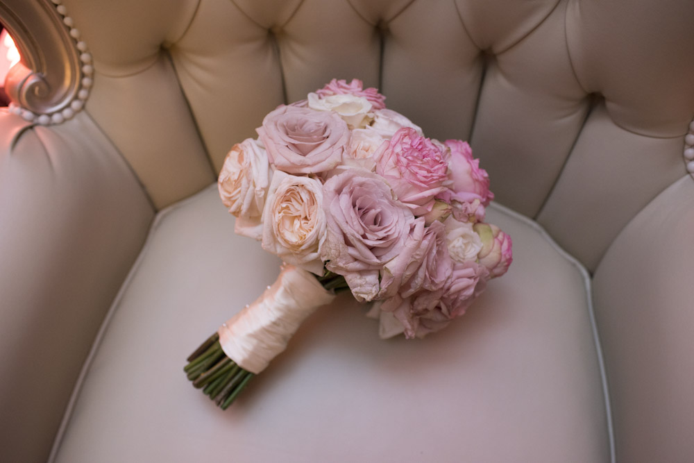 Bridal bouquet with pink roses and ivory ribbon.  Las Vegas Wedding Planner Andrea Eppolito.  Image by AltF Photography.   Floral and Decor by Destinations by Design. Luxury Wedding at Mandarin Oriental.