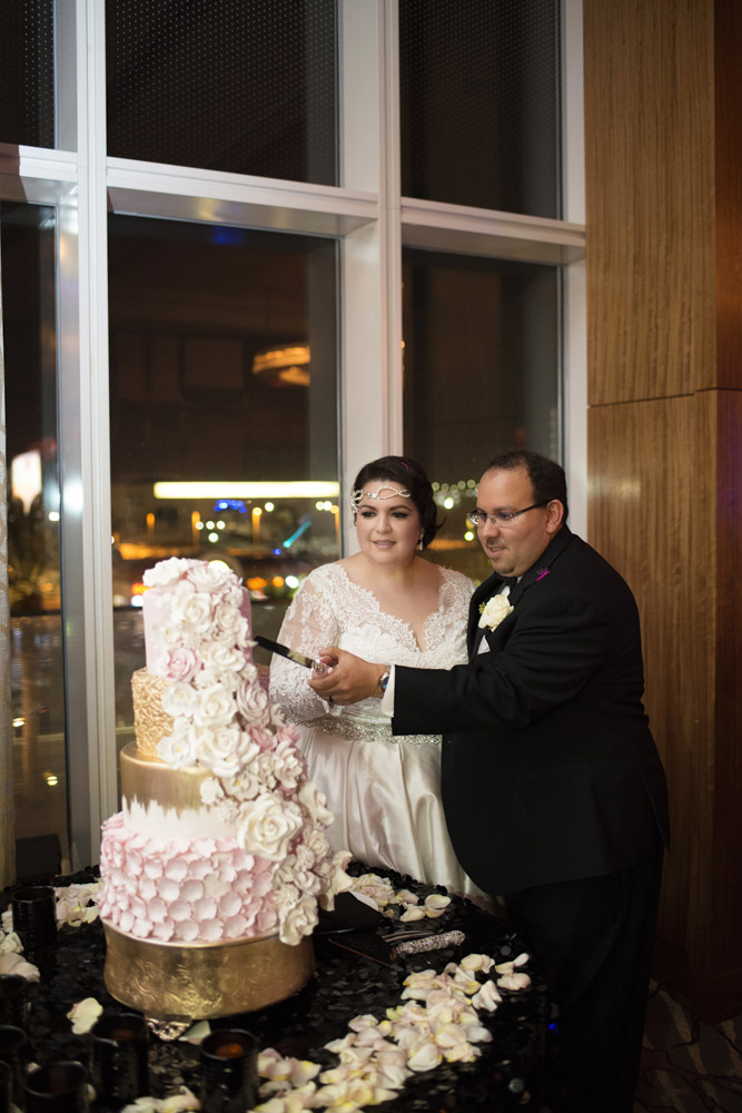 Wedding Cake Cutting.  Las Vegas Wedding Planner Andrea Eppolito.  Image by AltF Photography.   Floral and Decor by Destinations by Design. Luxury Wedding at Mandarin Oriental.