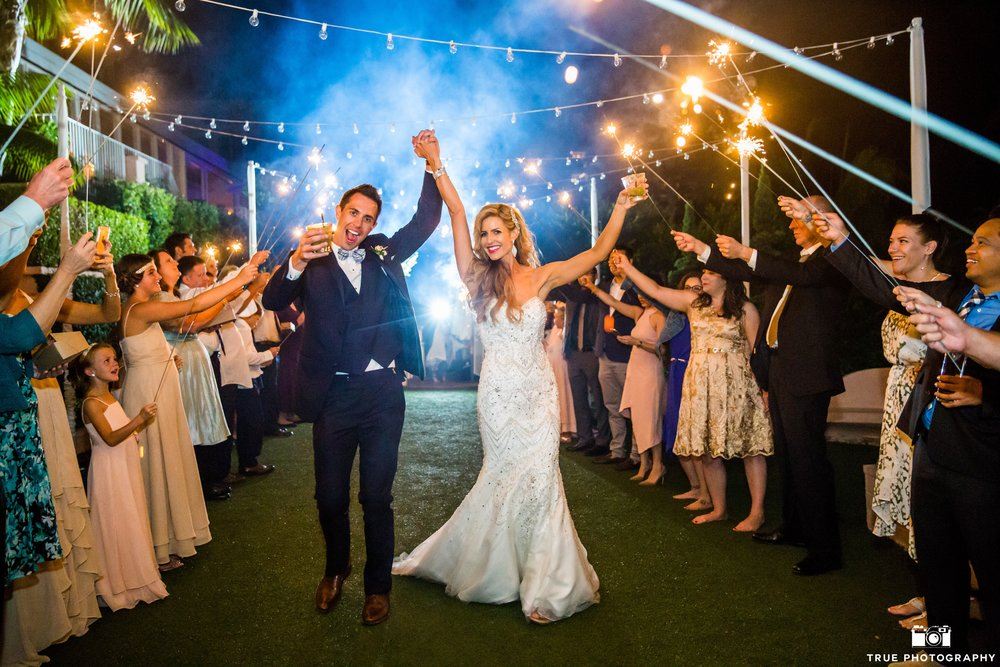 Nothing like a sparkler send off.  Photo by True Photography.