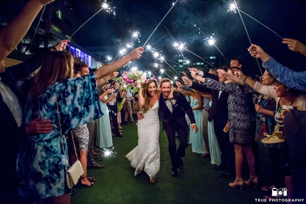 Long sparklers are a stunning way to end the evening.  Photo by True Photography.