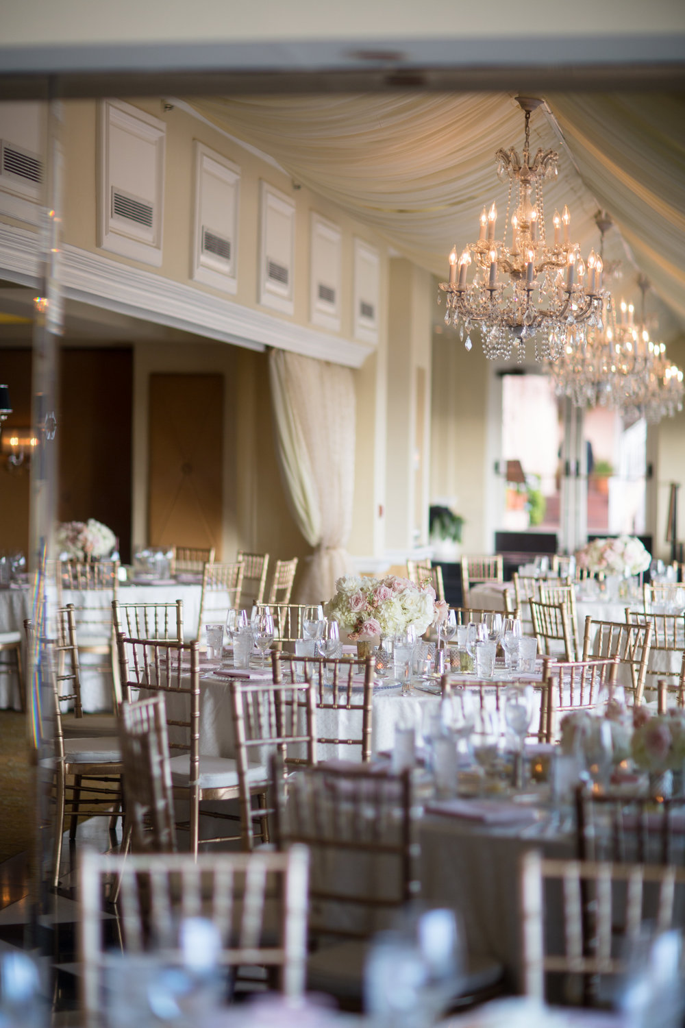 The existing chandeliers are a beautiful touch to the ballroom.