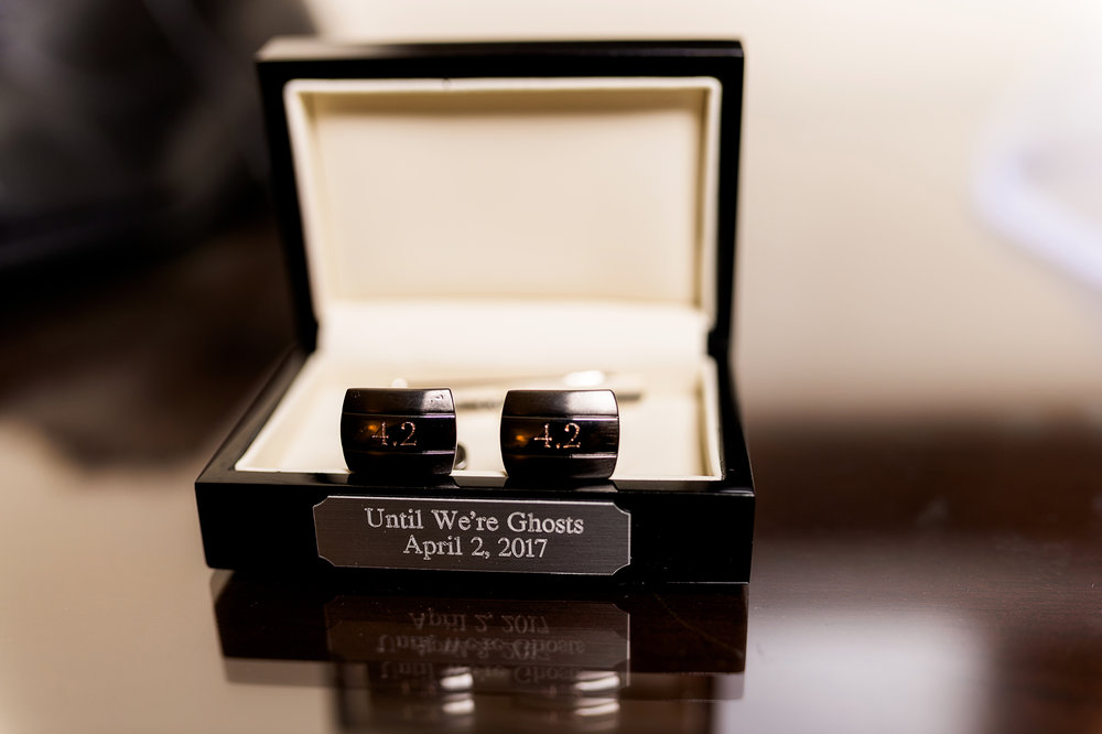 The bride gave the groom cufflinks as a wedding present.  Las Vegas Wedding Planner Andrea Eppolito.  Photo by Studio JK.
