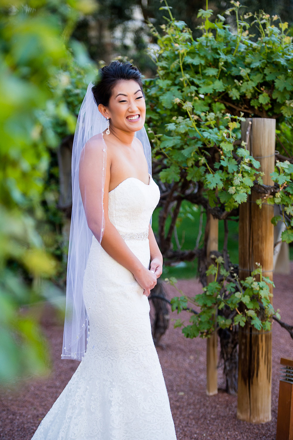 The bride wore a strapless white lace wedding dress and a gorgeous finger tip length veil. Las Vegas Wedding Planner Andrea Eppolito.  Photo by Studio JK.