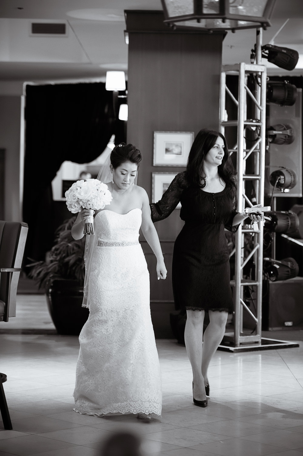 Luxury Wedding Planner Andrea Eppolito escorts the bride to her first look.  Las Vegas Wedding Planner Andrea Eppolito.  Photo by Studio JK.