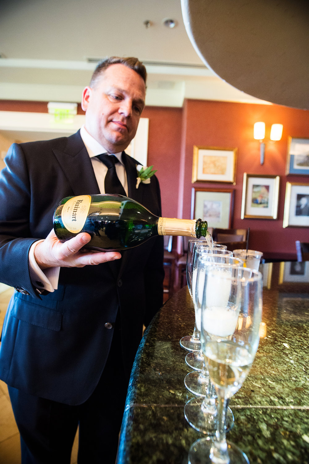 The groom pours off some bubbles before the first look. Las Vegas Wedding Planner Andrea Eppolito.  Photo by Studio JK.