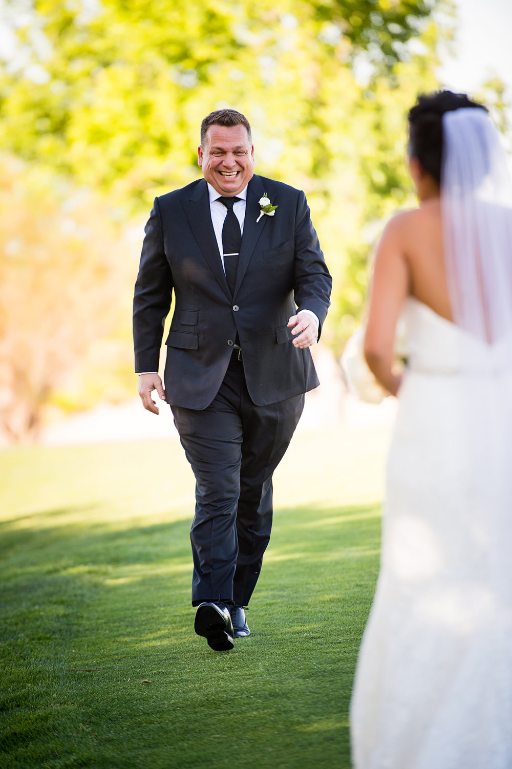 The groom's reaction to the first look. Las Vegas Wedding Planner Andrea Eppolito.  Photo by Studio JK.