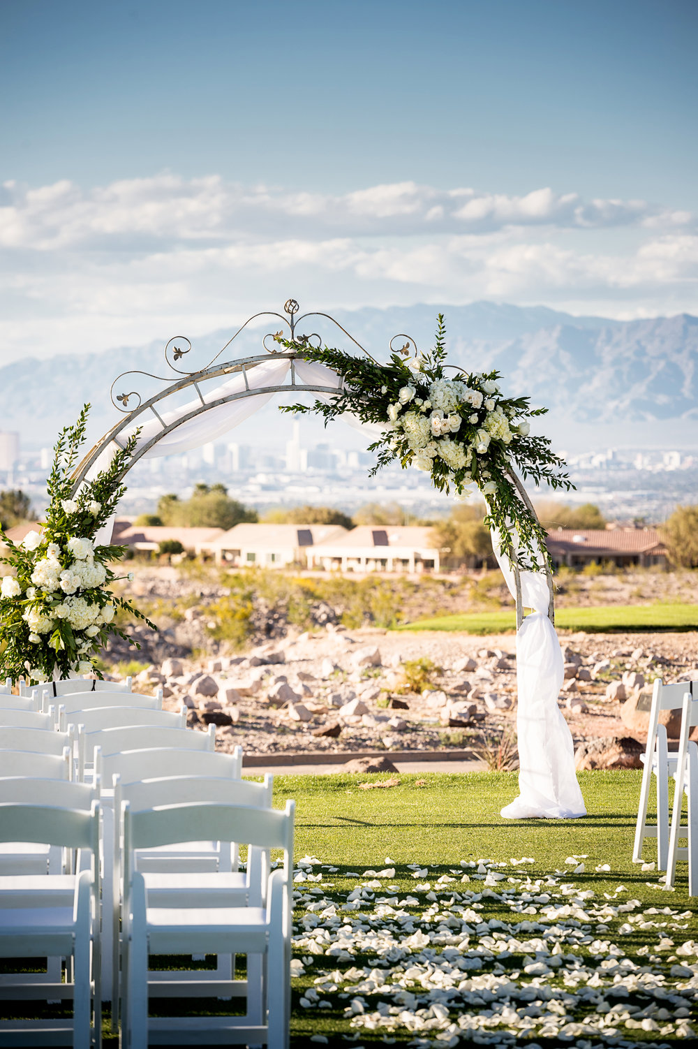 Wedding ceremony at Revere Golf Course.  FDesign by Naakiti Floral. Las Vegas Wedding Planner Andrea Eppolito.  Photo by Studio JK.