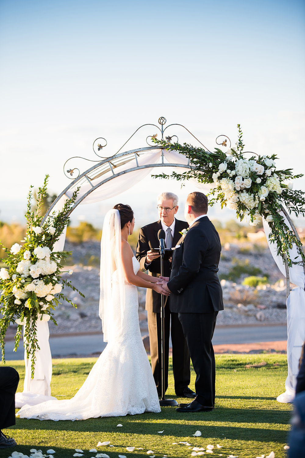Wedding Vows on the golf course. Las Vegas Wedding Planner Andrea Eppolito.  Photo by Studio JK.