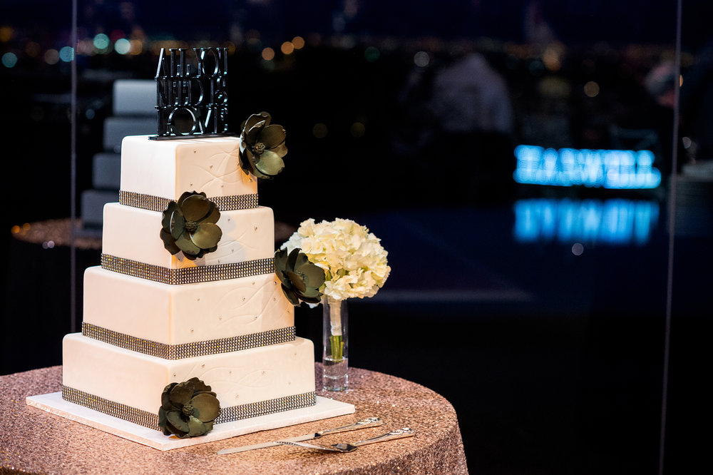 White wedding cake with black flowers. Las Vegas Wedding Planner Andrea Eppolito.  Photo by Studio JK.